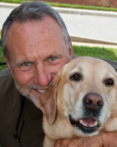 Brandywine CAD owner Jeff Applegate with his yellow lab Sam